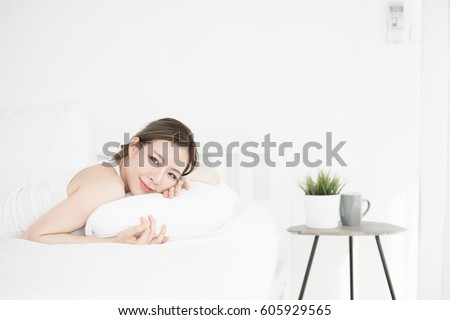 Young Asian woman wakes up and feels fresh in the morning. background beauty and healthy concept.