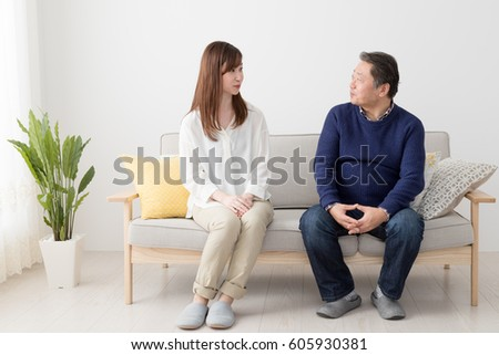 Father and daughter sitting on the sofa, parent and child, discussion #605930381