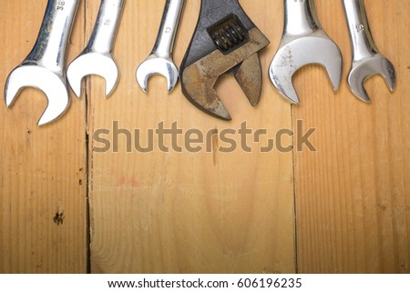 Various sizes of spanner/wrench over wooden background #606196235