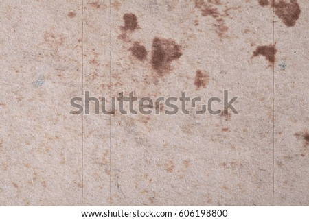 Brown abstract spots on textured fibrous paper or cardboard. Base for your ideas and projects. #606198800