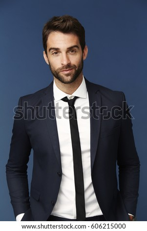 Handsome man suited in studio #606215000