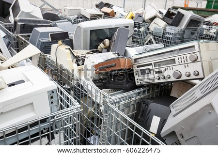 Electronic devices dump site. E-waste disposal, management, reuse, recycle and recovery concept. Electronic consumerism, globalization, raw material source concept.   #606226475