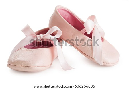 Pair of pink ballet shoes with bowknot for newborn baby. Isolated on a white background close up. #606266885