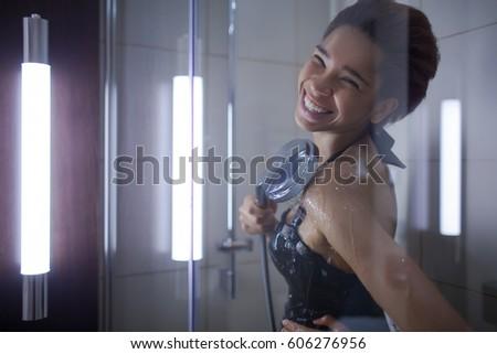 Beautiiful black girl taking a shower in the bathroom #606276956