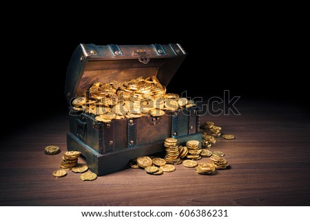 Open treasure chest filled with gold coins / HIgh contrast image #606386231