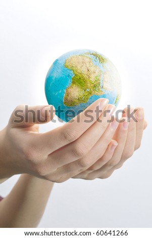 Female hands palms up on white background save the globe from falling. #60641266