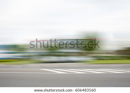 BLURRED MOTION OF QUICKLY MOVING CAR IN THE CITY STREET #606483560