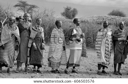 AMBOSELI, KENYA - OCT 13: Unidentified African people from Masai tribe prepare to show a traditional Jump dance on Oct 13, 2011 in Masai Mara, Kenya. They are nomadic and live in small villages. #606503576