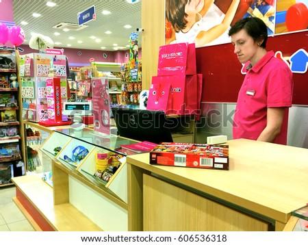 Kiev, Ukraine, MARCH 2017: The salesmanr in a toy store. #606536318