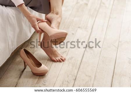 Frazzling young woman unshoe footwear #606555569