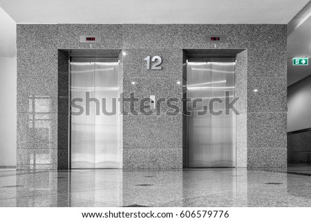 Modern elevator and granite tile.