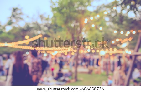 abstract blur image of  day festival  in garden with bokeh for background usage . (vintage tone) Royalty-Free Stock Photo #606658736