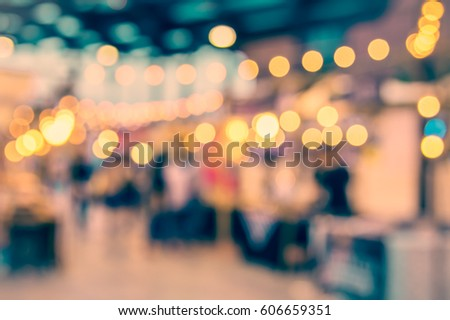 vintage tone blur image of night festival with bokeh for background usage . #606659351