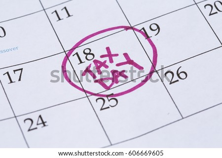 """An April monthly calendar with the 18th circled with the words """"Tax Day"""" written in the circle in a bright pink marker. #606669605"""