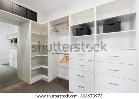Large walk in wardrobe cabinetry detail in new home #606670973