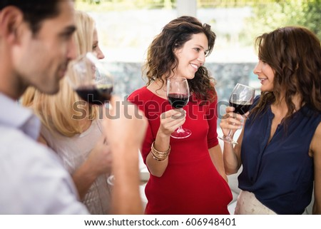 Group of friends having wine at the party #606948401