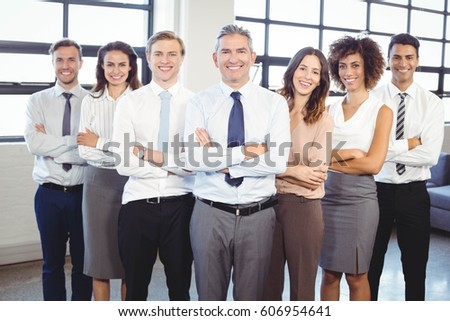 Portrait of businesspeople standing with arms crossed in office #606954641