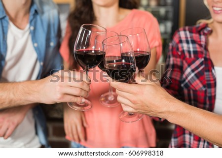 Friends toasting with wine at a bar #606998318