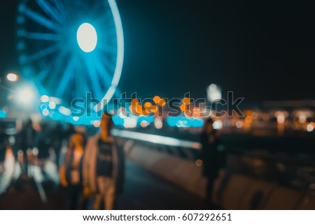 Abstract bokeh background of people walk on the waterfront at night  #607292651
