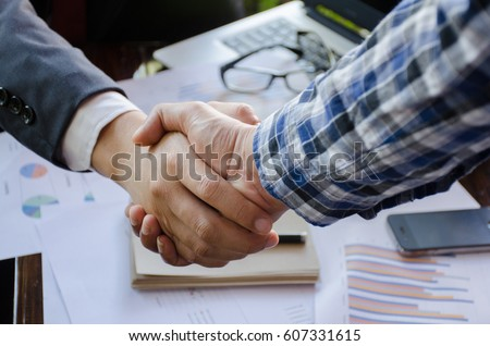 Business man handshake. Successful businessmen handshaking after good deal