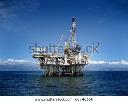 Large Pacific Ocean offshore oil rig drilling platform off the southern coast of California. Circa 2007. Royalty-Free Stock Photo #60746650