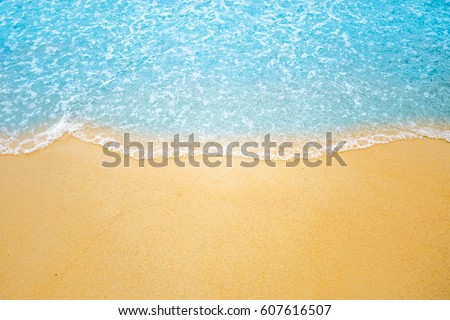 Soft wave of blue ocean on sandy beach. Background. #607616507