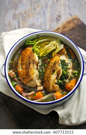 Herb and butter spring chicken dish with little gem lettuce, baby carrots, shallots and bacon #607713515