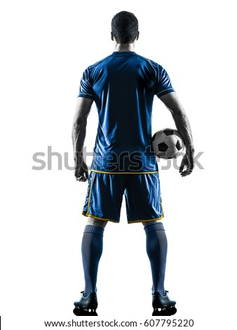 one caucasian soccer player man standing Rear View in silhouette isolated on white background Royalty-Free Stock Photo #607795220