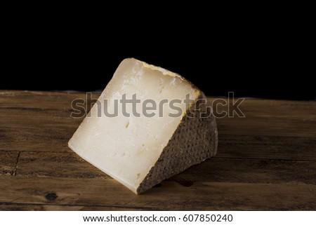 Tuscan pecorino cheese, typical Italian cheese on wooden cutting board #607850240