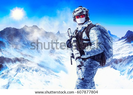 Soldier in winter uniforms and white face mask in the mountains. Weapon wrapped with masking camouflage tape #607877804