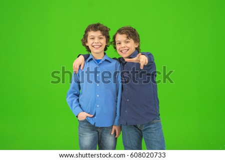 The two little twin gesture on the green background