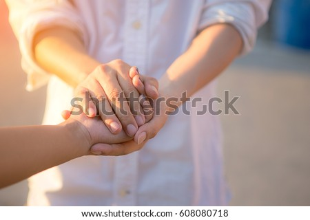 Man and woman holding hands closeup Royalty-Free Stock Photo #608080718