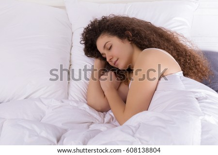 Beautiful girl sleeping in bed alone. #608138804
