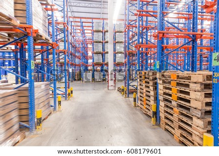 logistic, storage, shipment, industry and manufacturing concept - storing at warehouse shelves #608179601
