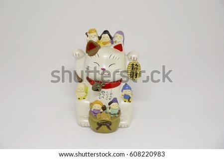 Japanese cat brings good luck #608220983