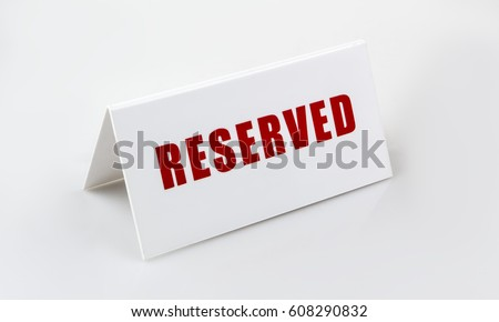 Reserved sign standing on the white background. Letters are red.  Royalty-Free Stock Photo #608290832
