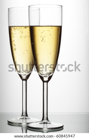 Two glasses of champagne over light gray white background #60845947