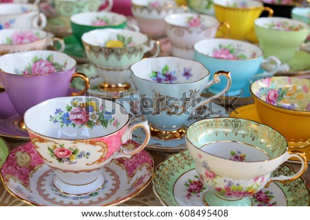 Pretty Pastel Tea Cups in Row - Afternoon Tea Party Royalty-Free Stock Photo #608495408