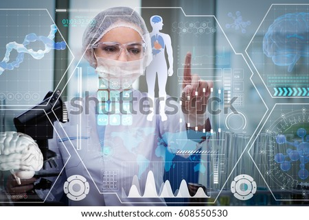 Doctor in futuristic medical concept pressing button Royalty-Free Stock Photo #608550530