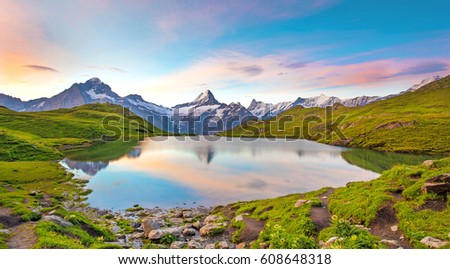 Fantastic landscape at sunrise over the lake in the Swiss Alps, Europe. Wetterhorn, Schreckhorn, Finsteraarhorn et Bachsee. ( relaxation, harmony, anti-stress - concept).  #608648318