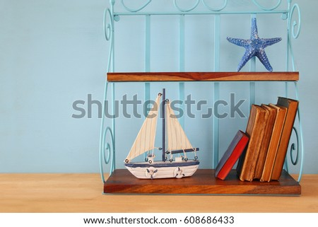 Nautical concept with sea life style objects on wooden table #608686433