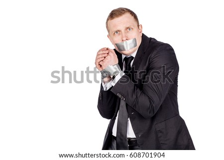 businessman with adhesive tape on his mouth and hands. danger, shock and hopeless concept #608701904