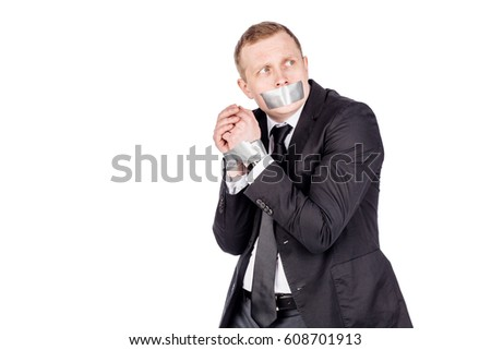 businessman with adhesive tape on his mouth and hands. danger, shock and hopeless concept #608701913
