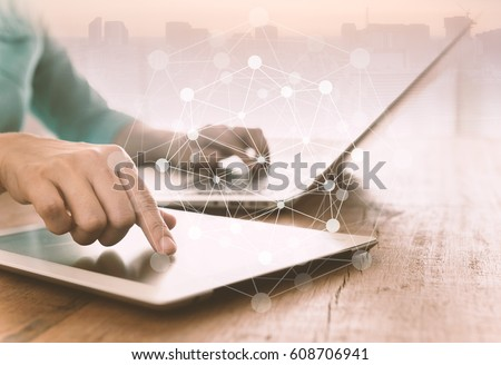 Global Connection Internet Concept. Human using digital tablet and laptop computer with digital network icon. Royalty-Free Stock Photo #608706941