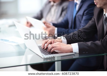 Young businessman working with laptop at office #608723870