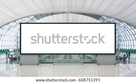 Blank advertising billboard in the Airport with path Royalty-Free Stock Photo #608755391