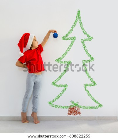 Toddler boy decorating Christmas tree