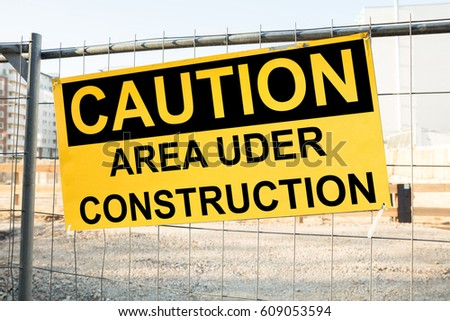 Close-up Of A Caution Sign On The Construction Site