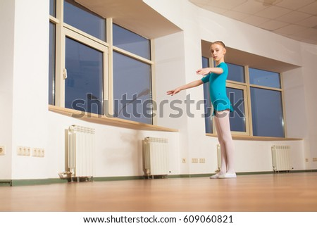 Young girl ballet dancer practicing in the hall for ballet lessons #609060821