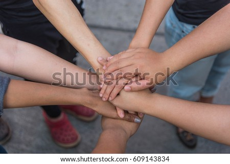 Workmate Join hands to fight for the job. #609143834